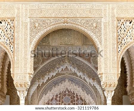 GRANADA, SPAIN- AUGUST 26, 2014: Arches in Islamic (Moorish)  style in Alhambra, Granada, Spain - stock photo