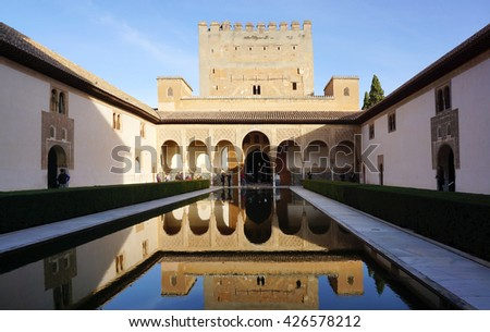 Granada, Spain - 9 December,2015 : Beautiful reflection on the water of Court of the Myrtles in Alhumbra, Granada, Spain on 9 December 2015 in Granada, Spain