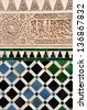 GRANADA, SPAIN - FEBRUARY 15: Mosaic walls at the Alhambra Palace in Granada, Spain on February 15, 2013. These decorations ushered in the last great period of Andalusian Art in Granada. - stock photo
