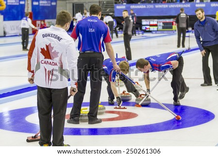 GRANADA, SPAIN   FEBRUARY 5, 2015: Winter Universiade, Granada 2015 curling Game between the national teams of USA and Canada, which ended with the victory of USA by 6-5