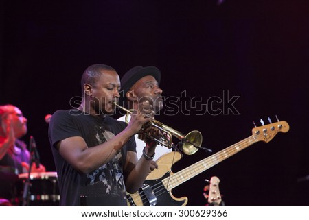 GRANADA, SPAIN - JULY 23, 2015: Marcus Miller and his band, Afrodeezia tour, at 28 International Jazz Festival of Almunecar, Spain.  Lee Hogans and Marcus Miller.