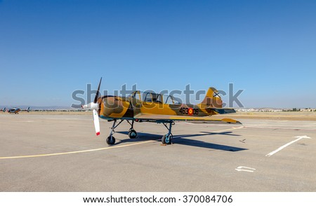 GRANADA, SPAIN-MAY 18: Airplane Yakovlev Yak-52 taking part in a exhibition on the X aniversary of the Patrulla Aspa of the airbase of Armilla on May 18, 2014, in Granada, Spain - stock photo