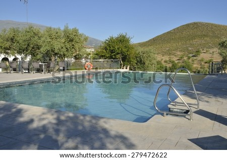 GRANADA, SPAIN - MAY 16, 2015: Swimming pool in Rural Hotel with stunning views the Sierra Nevada Sierra mountains on May 16, 2015 in the countryside of Granada, Spain.