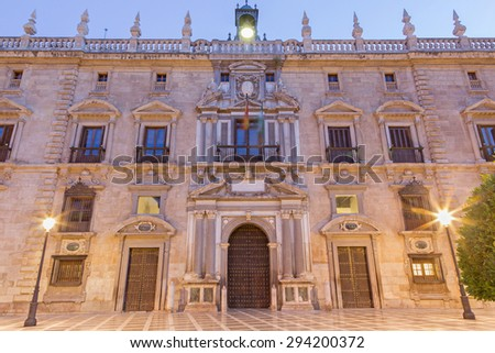 GRANADA, SPAIN - MAY 29, 2015: The facade of palace Real Chancilleria de Granada on the St. Ann square at dusk. - stock photo
