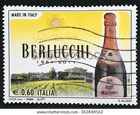 GRANADA, SPAIN - NOVEMBER 30, 2015: A stamp printed in Italy shows bottle Berlucchi, 2010 - stock photo