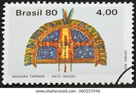 GRANADA, SPAIN - NOVEMBER 30, 2015:  stamp printed in Brazil shows Tapirape Mask Mato Grosso, 1980 - stock photo