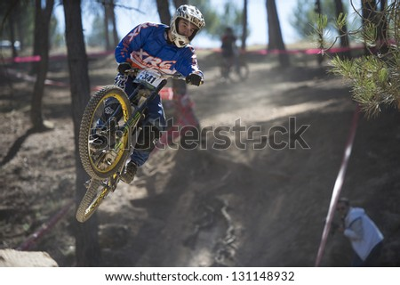 "GRANADA, SPAIN - OCTOBER 25: Unknown racer on the competition of the mountain downhill bike ""Cumbres Verdes, La Zubia"" on October 25, 2012 in Granada, Spain"