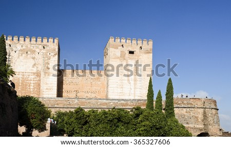 GRANADA, SPAIN - SEPTEMBER 8 2015: View of the Alcazaba with the Broken Tower (left) and the Tower of Homage (center) in The Alhambra complex, on September 8, 2015, in Granada, Spain - stock photo