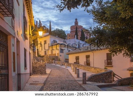 Granada - The ascent to Alhambra palace across the old street in morning dusk. - stock photo