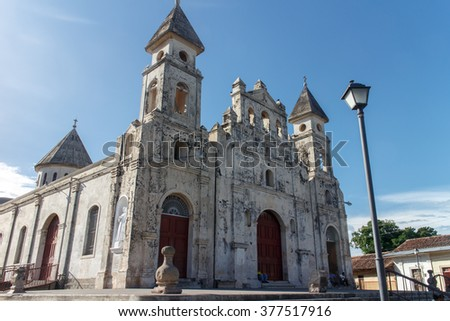 Granada - the colonial oldest Spanish city in Nicaragua has trim churches, the fine palm-covered plaza, and the colorful architecture. The picture present Guadalupe churc