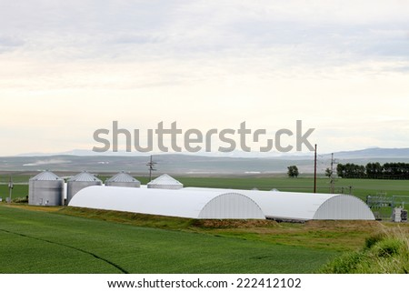 Granaries, and potato cellars on a farm - stock photo