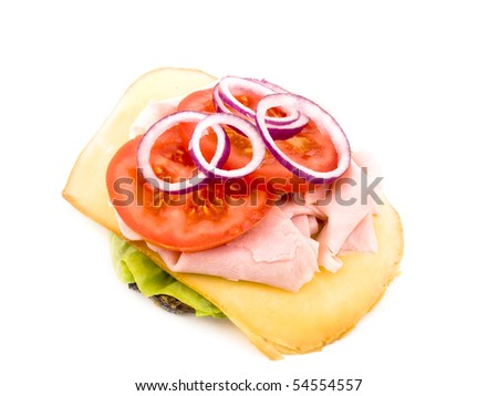 Granary bread with lettuce, smoked cheese, crumbled ham, sliced tomato and red onion on white background
