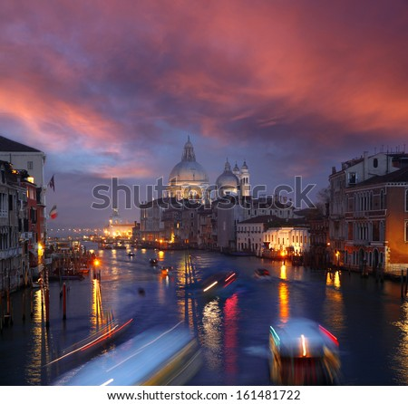 Grand Canal and Basilica Santa Maria della Salute during amazing evening in Italy - stock photo