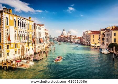 Grand Canal and Basilica Santa Maria della Salute in Venice - stock photo