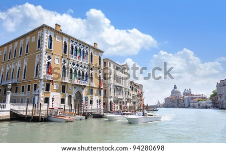 Grand Canal in Venice, Italy, with the domes of the Santa Maria della Salute in the background. - stock photo