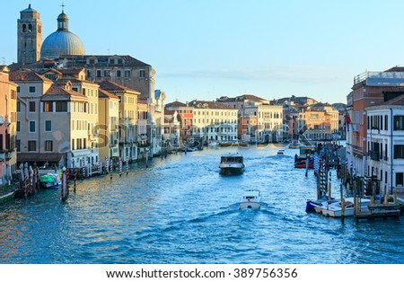 Grand Canal morning view with colorful houses and public transports on water. Venice, Italy.