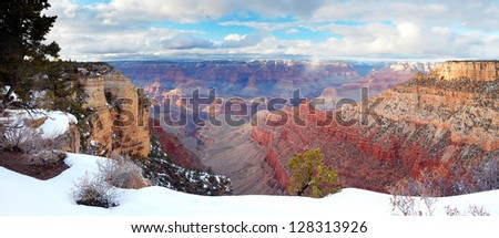 Grand Canyon panorama view in winter with snow and clear blue sky. - stock photo