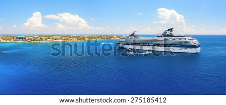 "GRAND CAYMAN, CAYMAN ISLANDS - APRIL 3, 2008: Celebrity ""Century"" cruise ship was tendered next to the shore. Over 2,500 guests went out to visit beautiful tropical island."