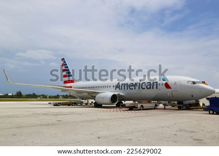 GRAND CAYMAN, CAYMAN ISLANDS -June 10:American Airlines Boeing 737 at Owen Roberts International Airport at Grand Cayman on June 10, 2014. In 2013 the American Airlines fleet consists of 621 aircraft  - stock photo