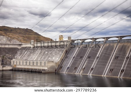 Grand Coulee Dam is a gravity dam on the Columbia River and is the largest electric power producing facility in the USA. It was constructed between 1933 and 1942, originally with two power plants. - stock photo
