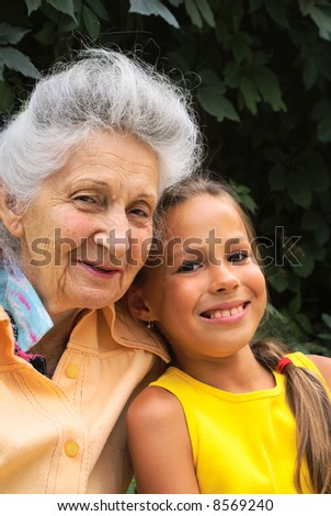 Grand daughter and her grand mother talking - stock photo