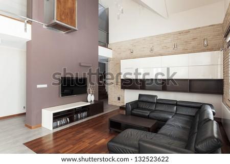 Grand design - Spacious living room with black sofa - stock photo