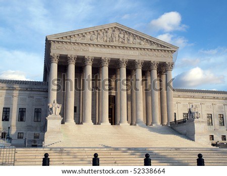 Grand entrance of the United States Supreme Court in warm afternoon light. - stock photo