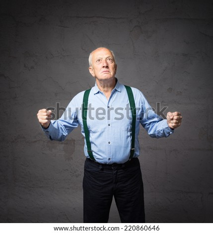 grand father powerful gesturing with open arms - stock photo