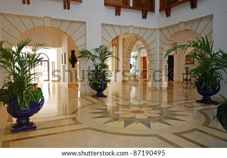 Grand foyer with marble floor in luxury hotel resort mansion - stock photo