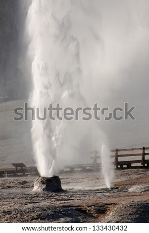 Grand Geyser and Vent in Yellowstone National Park - stock photo