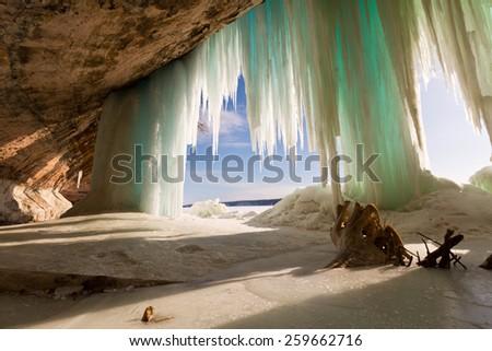 Grand Island ice curtains on Lake Superior, near Pictured Rocks National Lakeshore in Munising Michigan - stock photo