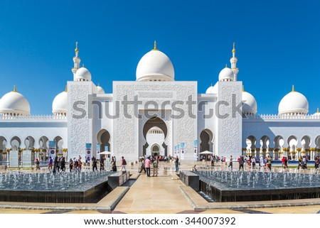 Grand Mosque, Abu Dhabi - February 12th 2015 - Tourists and locals visiting The Grand Mosque in Abu Dhabi in a blue sky day. United Arab Emirates.