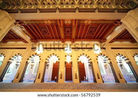 grand mosque in Oman luxury interior with arches and chandeliers - stock photo
