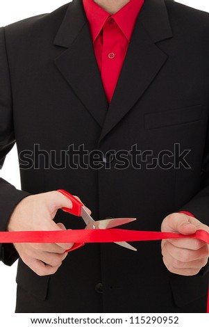 grand opening ceremony. man cutting the red ribbon with scissors - stock photo