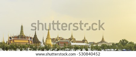 Grand palace and Wat phra keaw at sunset Bangkok, Thailand. Beautiful Landmark of Asia. Temple of the Emerald Buddha. landscape of the capital city