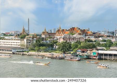 Grand palace with long tail boat in Chao Phraya River in Bangkok, Thailand - stock photo
