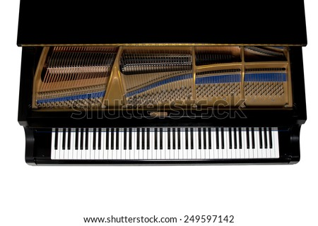 Grand piano.  Close up showing keys, harp, and hammers.  Viewed from above.  Isolated on white. - stock photo