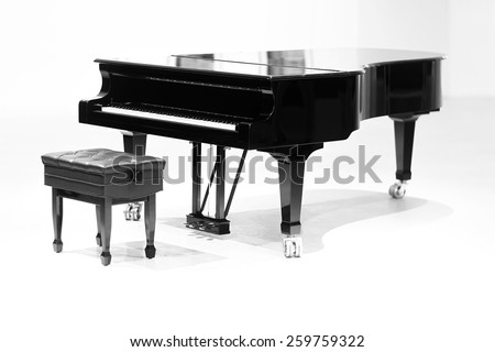 grand piano on white background with the chair