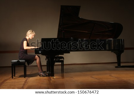 Grand piano pianist playing classical concert. Player with musical instrument - stock photo