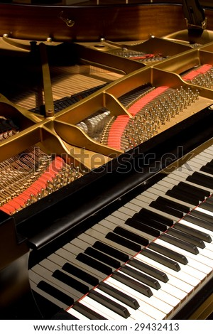 Grand Piano with cover open to see the rich detail - stock photo
