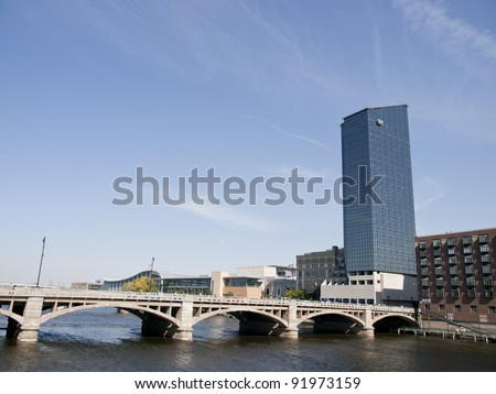 Grand Rapids Michigan USA beautiful downtown with large skyscrapers. The Grand River flows through the town. - stock photo