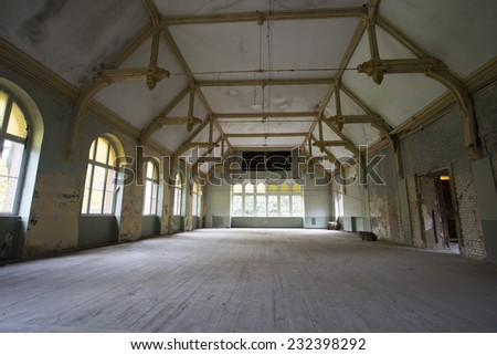grand room in old abandoned building / hospital in germany, Beelitz - stock photo