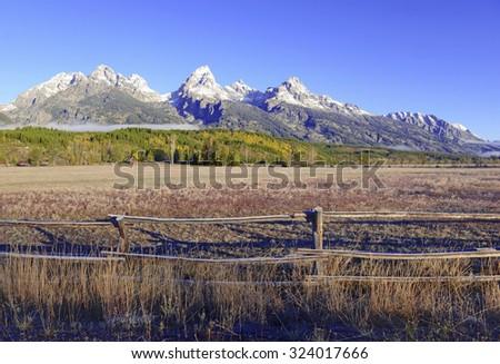 Grand Teton and the Teton Range, a popular peak to climb for mountain climbers in Grand Teton National Park, Wyoming, USA - stock photo
