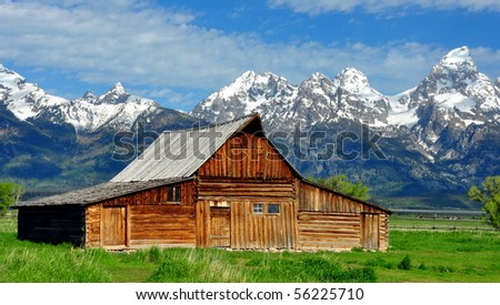 Grand Tetons and the T.A. Mouton Barn, Wyoming - stock photo