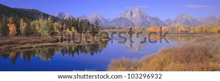 Grand Tetons reflected in Oxbow Bend, Wyoming - stock photo