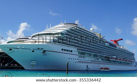GRAND TURK, TURKS AND CAICO - NOV 23: Carnival Breeze docked in Grand Turk, Turks and Caicos Islands, on Nov 23, 2015. It is a Dream-class cruise ship which entered service on June 3, 2012. - stock photo