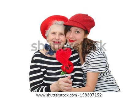 granddaughter and grandma with red heart on white background - stock photo