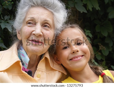 Granddaughter and her grandmother talking - stock photo