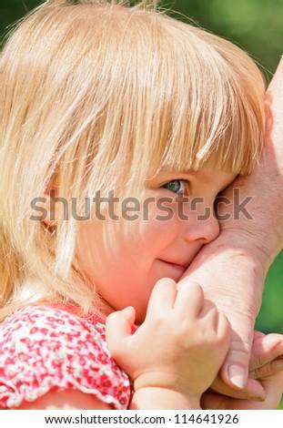 Granddaughter holding grandmother's hand closeup - stock photo