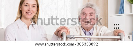 Granddaughter is spending time with her ill grandfather  - stock photo